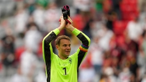 Germany's goalkeeper Manuel Neuer celebrates with fans after the Euro 2020 soccer championship group F match between Portugal and Germany in Munich, Saturday, June 19, 2021. (AP Photo/Matthias Schrader, Pool)