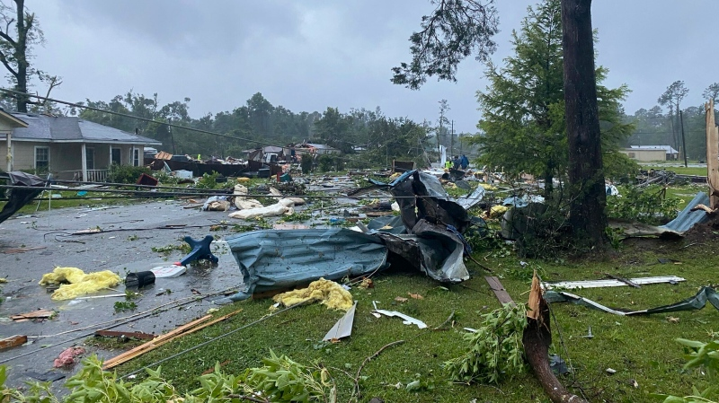 This photo provided by Alicia Jossey shows debris covering the street in East Brewton, Ala., on Saturday, June 19, 2021. (Alicia Jossey via AP)