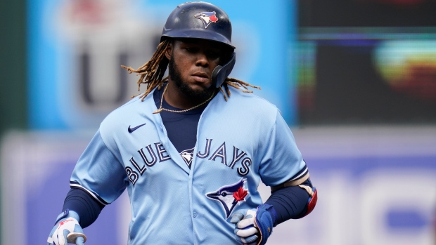 Toronto Blue Jays' Vladimir Guerrero Jr. runs the bases after hitting a solo home run off Baltimore Orioles starting pitcher Dean Kremer during the first inning of a baseball game, Saturday, June 19, 2021, in Baltimore. (AP Photo/Julio Cortez)