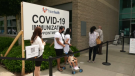 """People line up for a """"Vax-a-thon"""" at Surrey's Guildford Recreation Centre Saturday. (CTV)"""