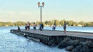 Many gather at Couchiching Beach Park following a water rescue that sent one person to hospital on Sat. June 19/21 (David Sullivan/CTV News Barrie)