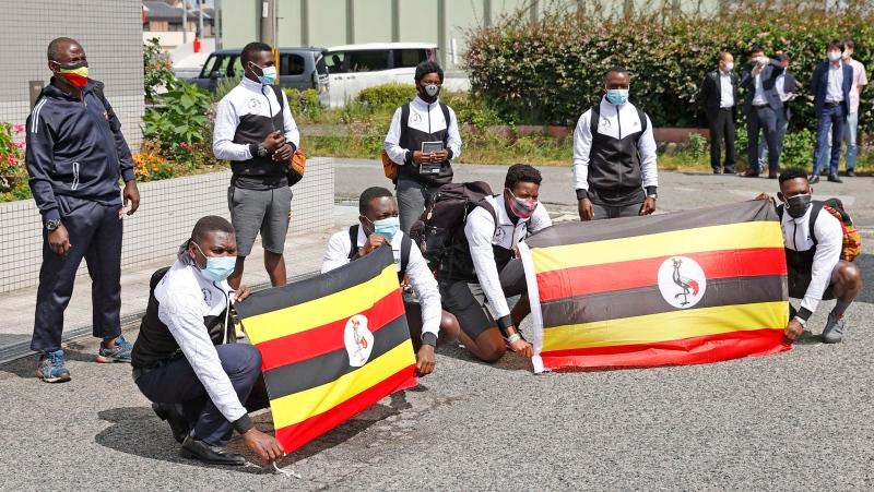 Members of Uganda's Olympic team pose for a photo on their arrival at their host town Izumisano, Osaka, western Japan Sunday, June 20, 2021. (Suo Takekuma/Kyodo News via AP)