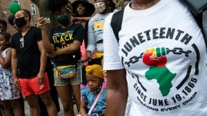 People attend Juneteenth celebrations in the Harlem neighborhood of New York, Saturday, June 19, 2021. (AP / Eduardo Munoz Alvarez)