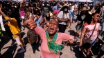 People dance as they celebrate during a Juneteenth commemoration at Leimert Park Plaza on Saturday, June 19, 2021, in Los Angeles. (AP / Ringo H.W. Chiu)