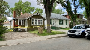 Police taped off a home on the 1300 block of Garnet Street on Friday in connection with a man's death. (Gareth Dillistone/CTV News Regina)