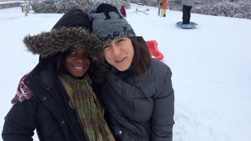 Atosha Ngage (left) and Karina Reid went on a trip to see snow as shown in this undated handout image. Ngage, a refugee from the Democratic Republic of Congo, just arrived in Canada and it's her first time to experience winter. Approximately four million Canadians are open for potential recruitment to a program that aims to sponsor refugees to the country, study. THE CANADIAN PRESS/HO-Karina Reid
