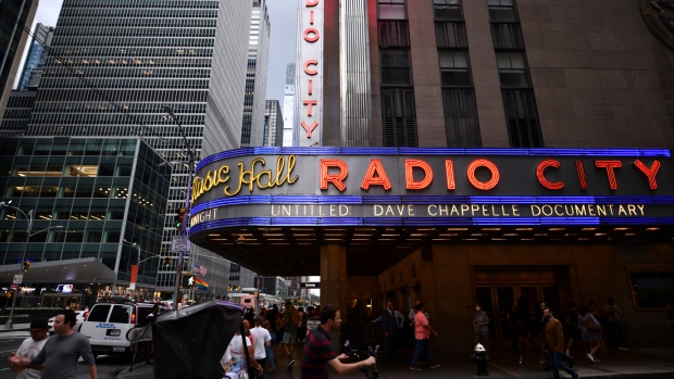 Radio City Music Hall's marquee advertises Dave Chappelle's untitled documentary during the closing night celebration for the 20th Tribeca Festival on Saturday, June 19, 2021, in New York. (Photo by Charles Sykes/Invision/AP)