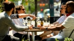 People enjoys drinks and friends on outdoor patios during the COVID-19 pandemic in downtown Toronto on Friday, June 11, 2021. THE CANADIAN PRESS/Nathan Denette