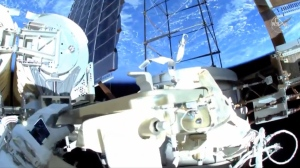 Astronauts ventured out on their second spacewalk in less than a week Sunday to install powerful new solar panels outside the International Space Station. (NASA)
