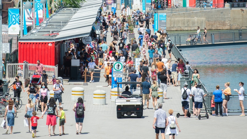 People walk in the Old Port in Montreal, Saturday, June 19, 2021, as the COVID-19 pandemic continues in Canada and around the world. THE CANADIAN PRESS/Graham Hughes