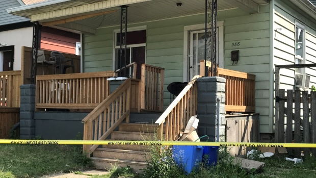 Police have sealed off the front and back of 588 Caron Avenue, after a man was found with serious injuries in a nearby parking lot. Sunday June 20, 2021 (Michelle Maluske/CTV Windsor)