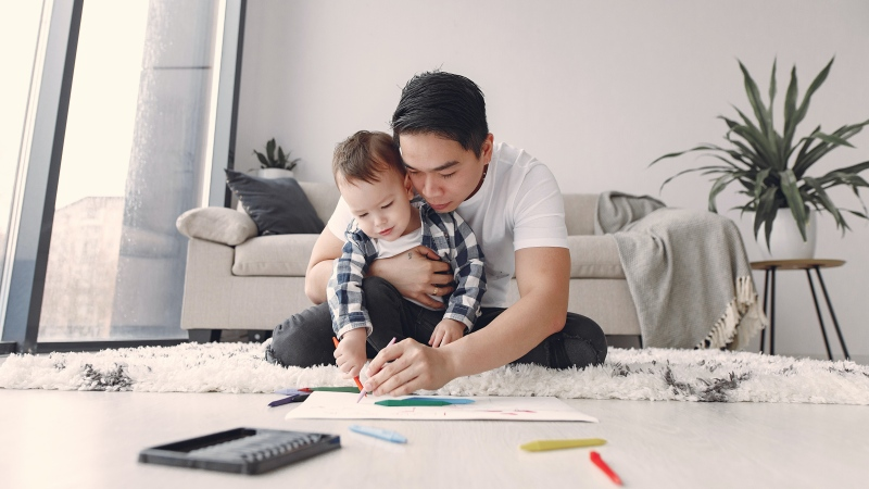 New research from the U.K suggests that the pandemic has led to fathers spending more time with their children and helping around the house more. (Pexels)