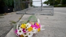 Flowers lie at the scene where a driver slammed into spectators at the start of a Pride parade Saturday evening, killing one man and seriously injuring another, Sunday, June 20, 2021, in Fort Lauderdale, Fla. Officials said the crash was an accident, but it initially drew speculation that it was a hate crime directed at the gay community. The driver and victims were all members of the Fort Lauderdale Gay Men's Chorus, who were participating in the Wilton Manors Stonewall Pride Parade. (AP Photo/Lynne Sladky)