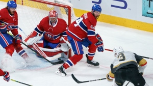 Vegas Golden Knights' Brayden McNabb scores past Montreal Canadiens goaltender Carey Price as Canadiens' Jon Merrill, left, and Joel Edmundson look on during third period game 4 NHL Stanley Cup playoff hockey semifinal action in Montreal, Sunday, June 20, 2021. THE CANADIAN PRESS/Paul Chiasson