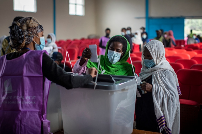 Ethiopians cast their votes in the general election at a polling centre in the capital Addis Ababa, Ethiopia, Monday, June 21, 2021. (AP Photo/Ben Curtis)