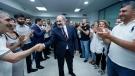 Armenian acting Prime Minister Nikol Pashinyan greets his party colleagues after parliamentary elections in Yerevan, Armenia, Monday, June 21, 2021. (Tigran Mehrabyan/PAN Photo via AP)