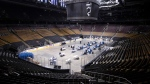 MLSE employees put together meals as they work on the floor of Scotiabank Arena, in Toronto on Wednesday, April 22, 2020. THE CANADIAN PRESS/Chris Young