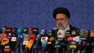 Iran's new President-elect Ebrahim Raisi speaks during a press conference in Tehran, Iran, on June 21, 2021. (Vahid Salemi / AP)