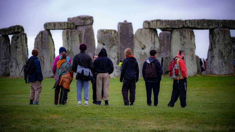 People view the stones during Summer Solstice at Stonehenge in Amesbury, England, on June 21, 2021. (Ben Birchall / PA via AP)