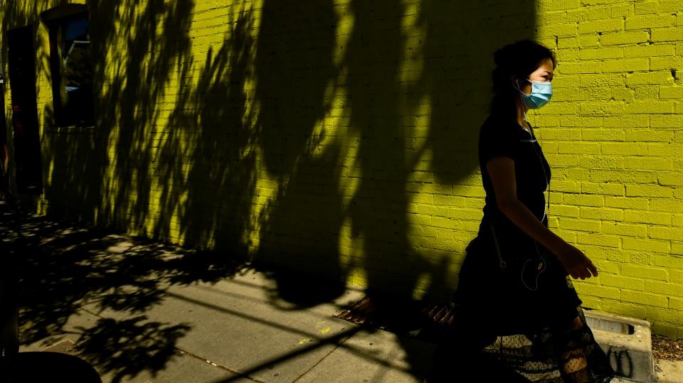 toronto, covid-19, woman walking