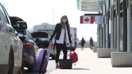 A traveller is dropped off at the departures level of the Ottawa MacDonald-Cartier International Airport on Wednesday, June 16, 2021. THE CANADIAN PRESS/David Kawai