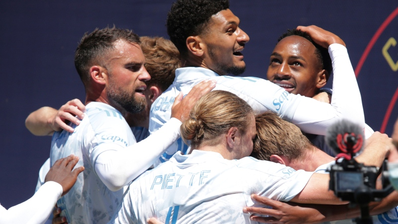 CF Montreal teammates celebrate with forward Mason Toye, right, after he scored during the second half of an MLS soccer match against the Chicago Fire Saturday, May 29, 2021, in Chicago. (AP Photo/Eileen T. Meslar)