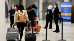 Travellers arrive at Terminal 3 at Pearson Airport in Toronto in this February 22, 2021 file photo. THE CANADIAN PRESS/Frank Gunn