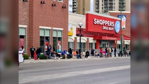 People line up outside of the Shopper's Drug Mart in Osborne Village for a walk-in appointment to receive a COVID-19 vaccine on June 21, 2021 (CTV News Photo Scott Andersson)