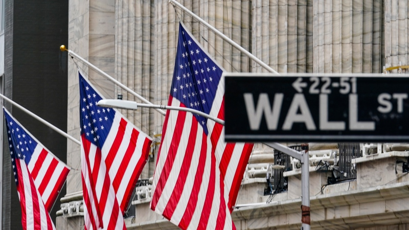 American flags hang outside of the New York Stock Exchange, in this Tuesday, Feb. 16, 2021, file photo. (AP Photo/Frank Franklin II, File)