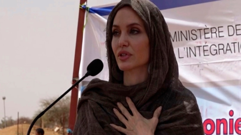 In this image taken from video, Special Envoy to the United Nations High Commissioner for Refugees Angelina Jolie speaks at the Malian refugee camp in Goudebo, Burkina Faso, Sunday June 20, 2021, to mark World Refugee day on Sunday. (AP Photo)