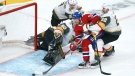 Montreal Canadiens' Corey Perry can't get the puck past an net left empty by Vegas Golden Knights goaltender Robin Lehner as he is held back by defenceman Nick Holden during first period game 4 NHL Stanley Cup playoff hockey semifinal action in Montreal, Sunday, June 20, 2021. THE CANADIAN PRESS/Paul Chiasson
