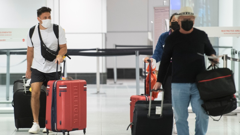 Passengers are shown in the international arrivals hall at Montreal-Trudeau Airport in Montreal, in this December 29, 2020 file photo. THE CANADIAN PRESS/Graham Hughes