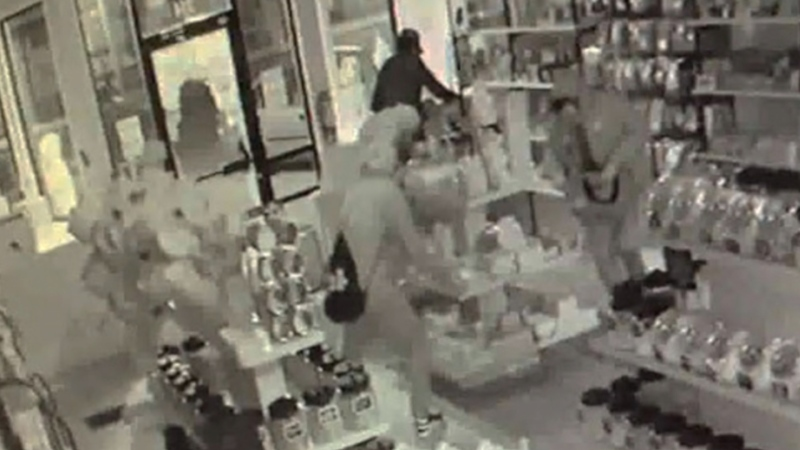 Surveillance image still of three suspects helping themselves to some of the offerings at the How Sweet Inc. candy shop in Lethbridge shortly before 4 a.m. on June 16 (LPS)