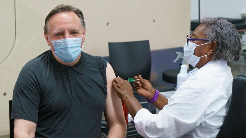 Quebec Premier François Legault receives his second dose of Pfizer vaccine from Regine Laurent, former president of the Fédération interprofessionnelle de la santé du Québec (FlQ), at a COVID-19 vaccination clinic in Montreal, on Monday, June 21, 2021. THE CANADIAN PRESS/Paul Chiasson