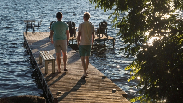 Chris Van Lierop, left, and Tim Wisener are seen at their cottage home on Sturgeon Lake near Fenelon Falls, Ont., on Wednesday, July 18, 2018. THE CANADIAN PRESS/Fred Thornhill