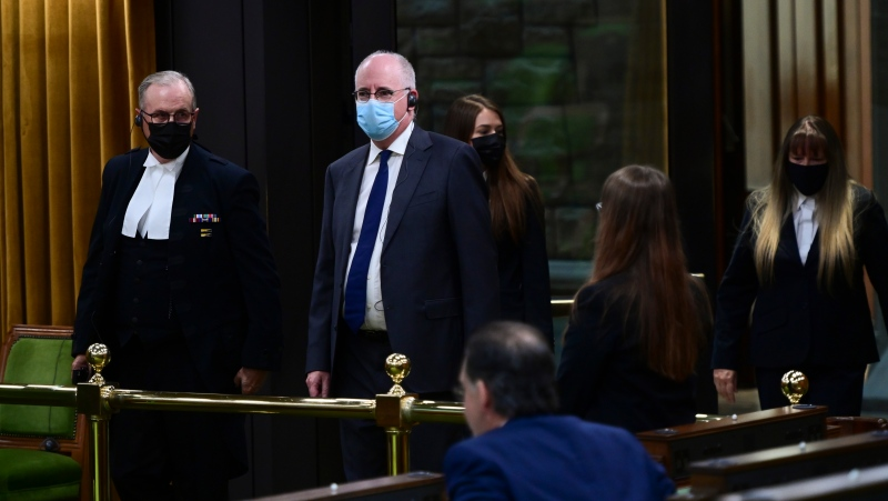 President of the Public Health Agency of Canada Iain Stewart, second from left, approaches the bar in the House of Commons to be admonished by the Speaker of the House of Commons Anthony Rota on Parliament Hill in Ottawa on Monday, June 21, 2021. THE CANADIAN PRESS/Sean Kilpatrick