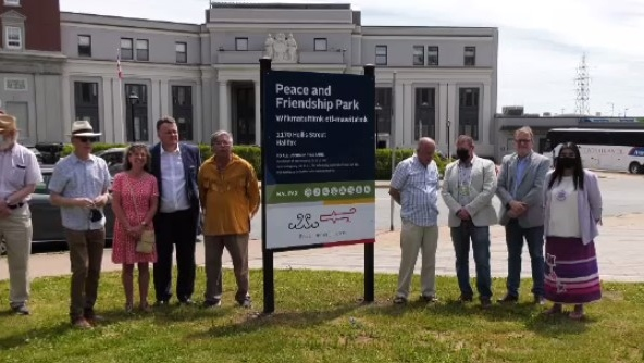 A sizable group of largely invited dignitaries gathered under the midday sun for the event, which culminated with the unveiling of a new sign, designating the space as Peace and Friendship Park.