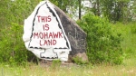 A rock in Kahnawake lets all passersby know that the land belongs to the Mohawks on Montreal's South Shore.