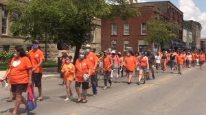 Hundreds dressed in orange walk through downtown St. Thomas, Ont. for the 'Every Child Matters' walk on Monday, June 21, 2021. (Brent Lale / CTV News)