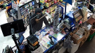 Police are searching for a suspect in a robbery at a Cambridge convenience store on June 20. The suspect is described as a white male in his 20s with a thin build and last seen wearing all black clothing and black and white gloves. (Supplied by WRPS)