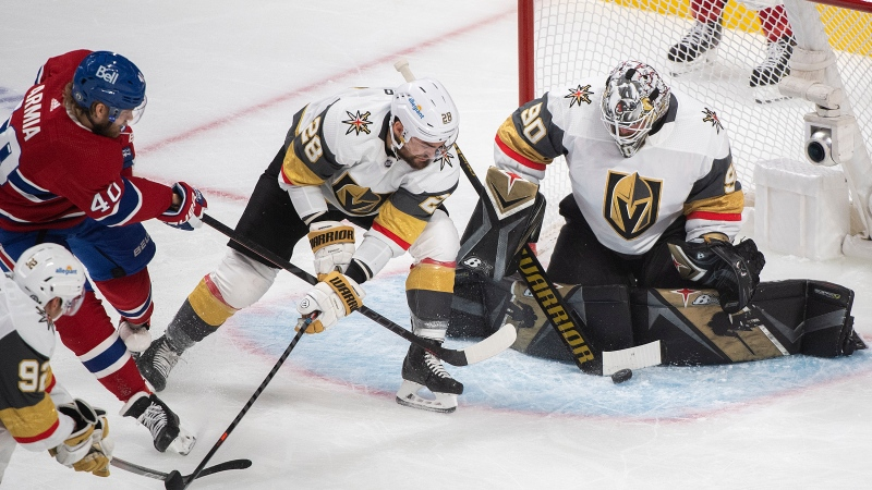 Montreal Canadiens' Joel Armia (40) takes a shot on Vegas Golden Knights goaltender Robin Lehner as Knights' William Carrier (28) defends during first period game 4 NHL Stanley Cup playoff hockey semifinal action in Montreal, Sunday, June 20, 2021. THE CANADIAN PRESS/Graham Hughes