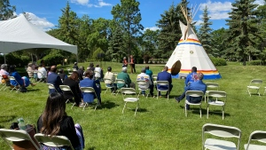 A traditional ceremony was held at the future site of a monument honouring and remembering those who attended residential schools at Government House in Regina. (Cole Davenport/CTV News)