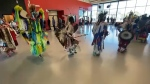 Dancers make a grand entry at the opening of Manyhorses High School on Tsuut'ina First Nation which was commenorated on National Indigenous People's Day