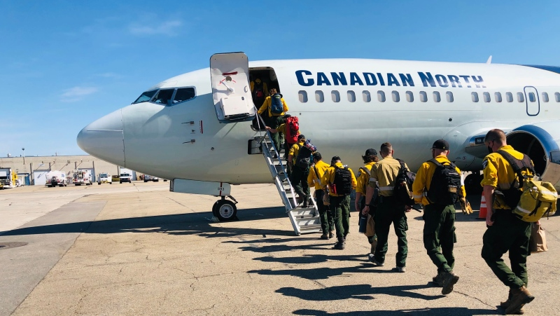 Alberta Wildfire personnel board a plane Monday morning bound for northern Ontario (Source: Alberta Wildfire)