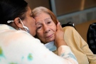 Rosa DeSoto, left, embraces her 93-year-old mother Gloria DeSoto, who suffers from dementia, inside the Hebrew Home at Riverdale, Sunday, March 28, 2021, in the Bronx borough of New York. (AP Photo/Kathy Willens)