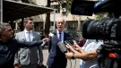 Members of Carlos Ghosn's defense team, lawyer Jean Yves Le Borgne, right, and Jean Tamalet, left, speak with journalist outside the Justice Palace in Beirut, Lebanon, Friday, June 4, 2021. (AP Photo/Hassan Ammar)