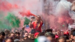 Hungarian fans march towards the Puskas Arena in Budapest, Hungary, on June 15, 2021. (Zoltan Balogh / MTI via AP)