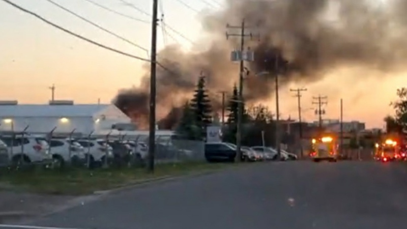 Heavy smoke from a burning trailer in a commercial yard along Moraine Road N.E. Tuesday morning. (Courtesy: Twitter/@erikaacford)