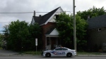London police guard the scene of a suspicious fire on Hamilton Road in London, Ont. on Tuesday, June 22, 2021. (Marek Sutherland / CTV London)