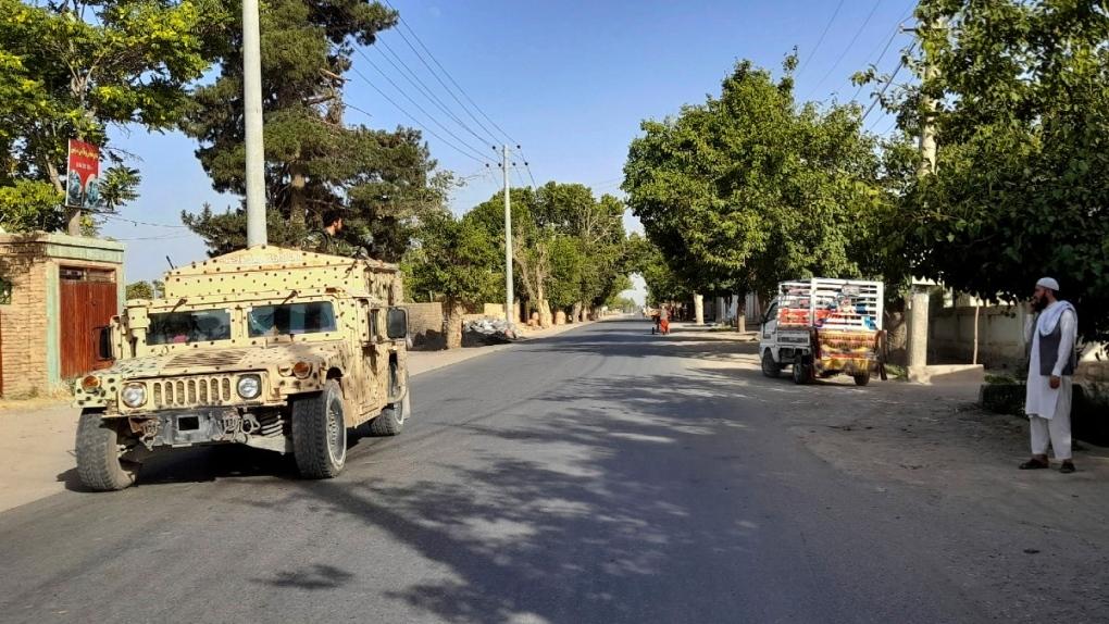 An Afghan army Humvee patrols in Kunduz